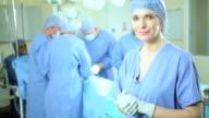 Portrait Female Nurse Wearing Scrubs Operating Room video