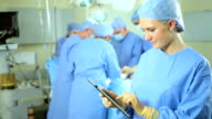 Portrait Female Nurse Wireless Tablet Foreground Operating Room video