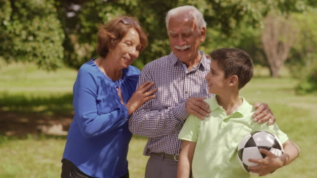 Portrait Happy Family Grandparents And Boy With Soccer Ball video