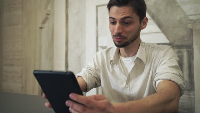 Portrait man using app on touch tablet screen video