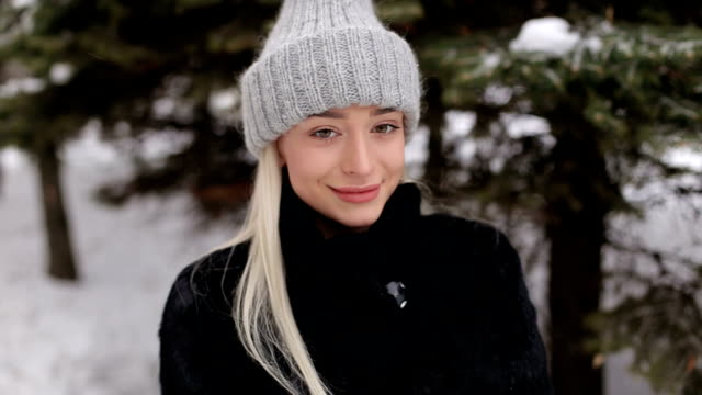 Portrait of a beautiful blonde in winter outdoors. video
