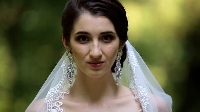 Portrait of a beautiful bride on the nature video