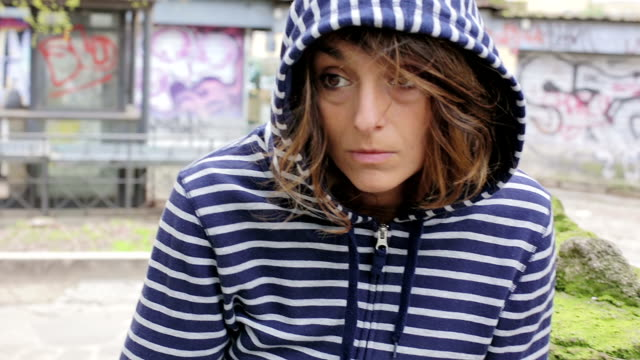 Portrait of a beautiful girl on the street. Sad and depressed woman. video