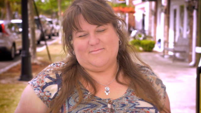 Portrait of a beautiful happy overweight woman smiling for the camera video