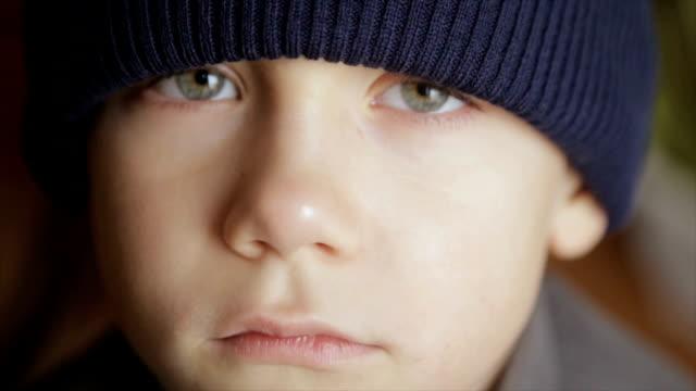 Portrait of a boy in winter hat. Full hd video video