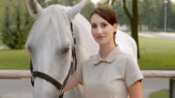 SLO MO Brunette woman posing with white horse video