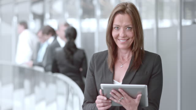 DS Portrait of a business woman working on a tablet and smiling video