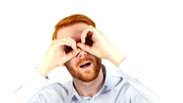 Portrait of a businessman using binoculars, searching for opportunities , video