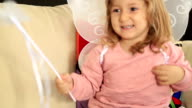 Portrait of a cute little girl with angel wing video