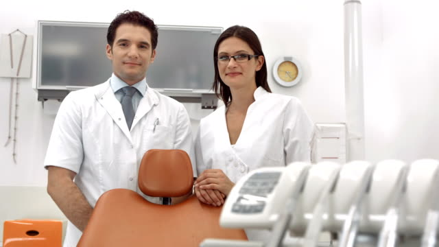 HD DOLLY: Portrait Of A Dentist And Dental Assistant video