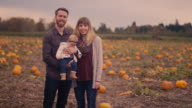 Portrait of a family at a pumpkin patch video