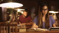 DS Portrait of female Asian student studying in library video