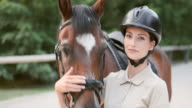 SLO MO Portrait of female rider and bay horse video