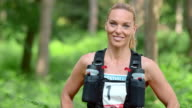 SLO MO DS Portrait of female marathon competitor in forest video