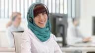 DS Portrait of a female Muslim call center operator video