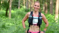 SLO MO Portrait of female trail running competitor in forest video