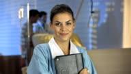 HD DOLLY: Portrait Of A Friendly Pediatric Nurse video
