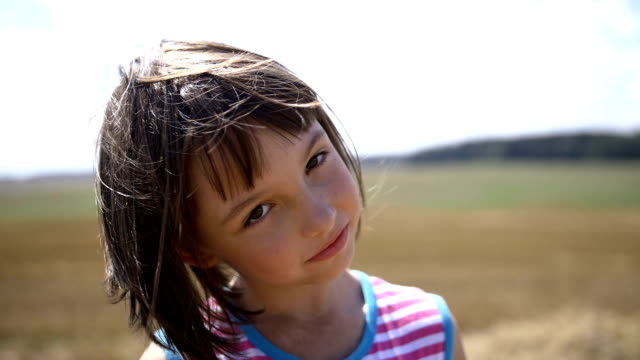 portrait of a girl looking at the camera and smiling video