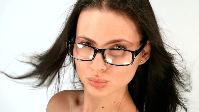 Portrait of a girl with long hair, she poses in glasses video