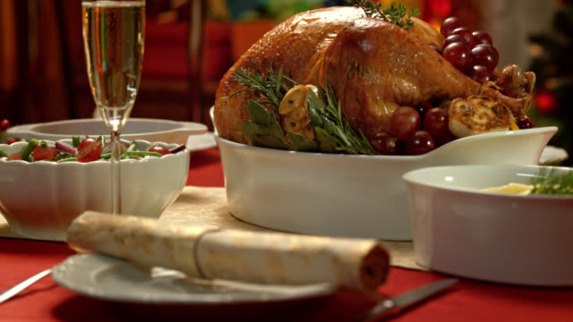 Portrait of a golden and crisp turkey on a Christmas table video