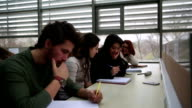 Portrait of a group of students sitting together in the library video