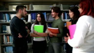 Portrait of a group of students standing together in the library video