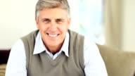 Portrait of a happy mature man video