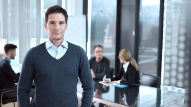 DS Portrait of a male employee in conference room video