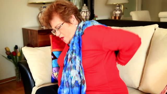 Portrait of a painful elderly woman having backache video