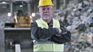 SLO MO portrait of a recycling facility worker video