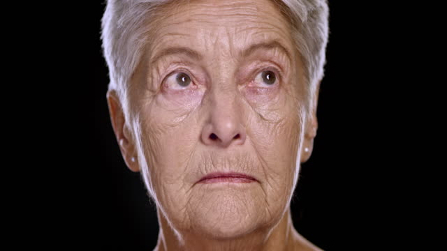 Portrait of a senior Caucasian female moving her eyes around video