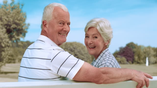 SLO MO Portrait of a senior couple sitting on a park bench video
