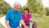 SLO MO Portrait of a senior couple with their bikes video