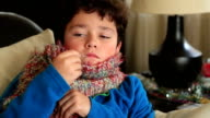Portrait of a sick child feeling cold in winter video