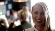 Portrait of a smiling blonde woman in bar video