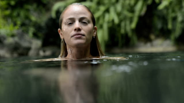 Portrait of a woman in the water video