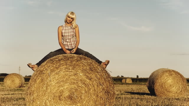 HD DOLLY: Portrait Of A Woman On Hay Bale video