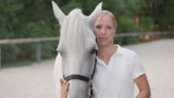SLO MO Portrait of a woman with white horse video
