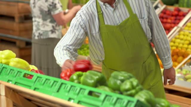 HD: Portrait Of A Worker In Greengrocer'S Shop video