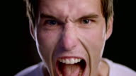 Portrait of a young Caucasian male yelling with anger video