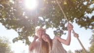 SLO MO Portrait of a young couple laughing on a swing video