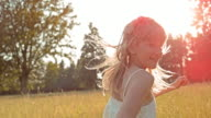 SLO MO TS Portrait of a young girl with long hair running through high grass video