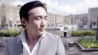 Portrait of a young handsome Asian man video