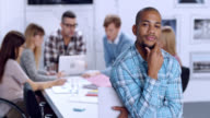 Portrait of a young male in business startup office video