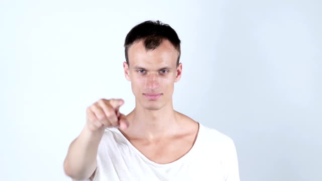 Portrait of a young man pointing his finger at you video