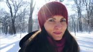 Portrait of a young woman in winter forest. video
