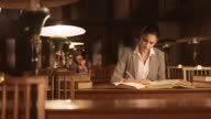 DS Portrait of woman studying in library video