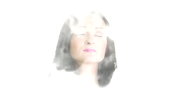 Portrait of a young woman who appears out of the smoke video