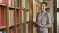 DS Portrait of woman with tablet in library video