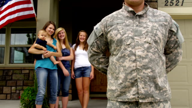 Portrait of American soldier with family in background video